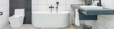 Bathroom with a white bathtub, toilet and sink